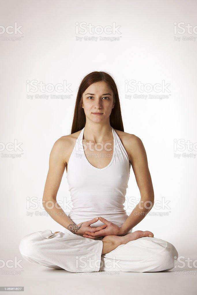 Woman in lotus Yoga posture (Padmasana) royalty-free stock photo