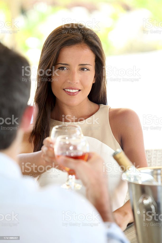 Woman in love talking to her husband during romantic dinner royalty-free stock photo