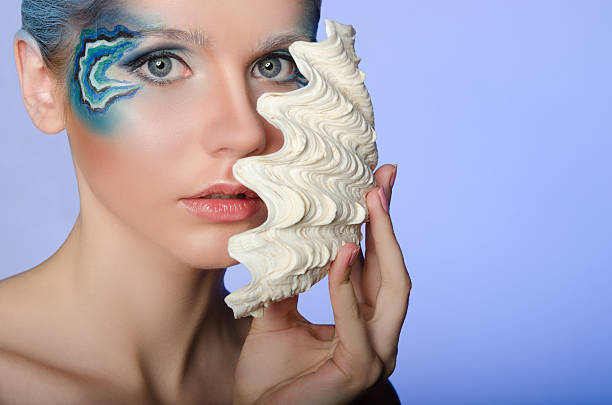 woman in make mermaid with seashell - meerjungfrau fantasy make up stock-fotos und bilder