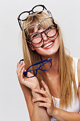 Young blond woman in many spectacles, portrait