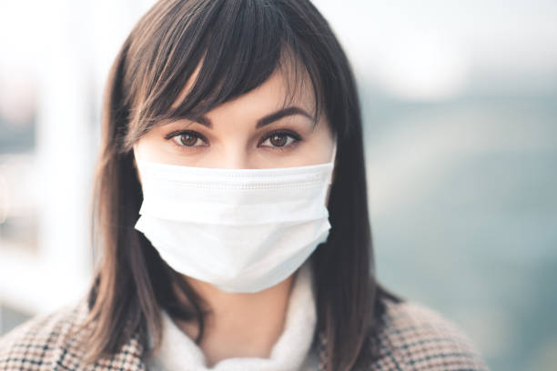 Woman in medical mask stock photo