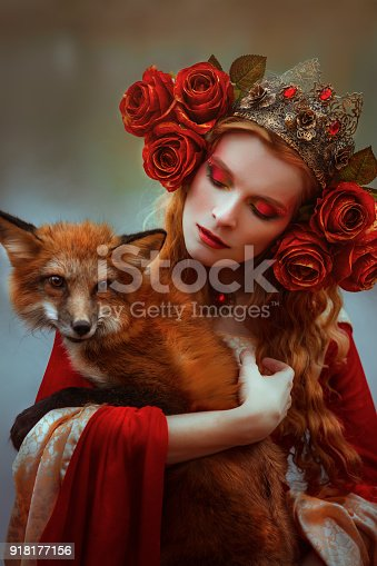 861629426 istock photo Woman in medieval clothes with a fox 918177156