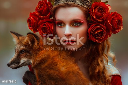 861629426 istock photo Woman in medieval clothes with a fox 918179310