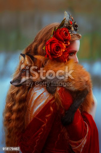 861629426 istock photo Woman in medieval clothes with a fox 918179462