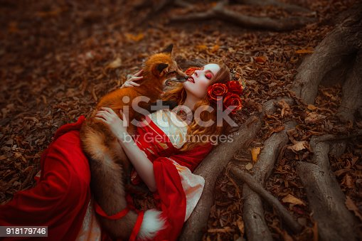 861629426 istock photo Woman in medieval clothes with a fox 918179746