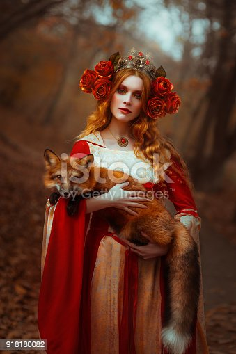 861629426 istock photo Woman in medieval clothes with a fox 918180082