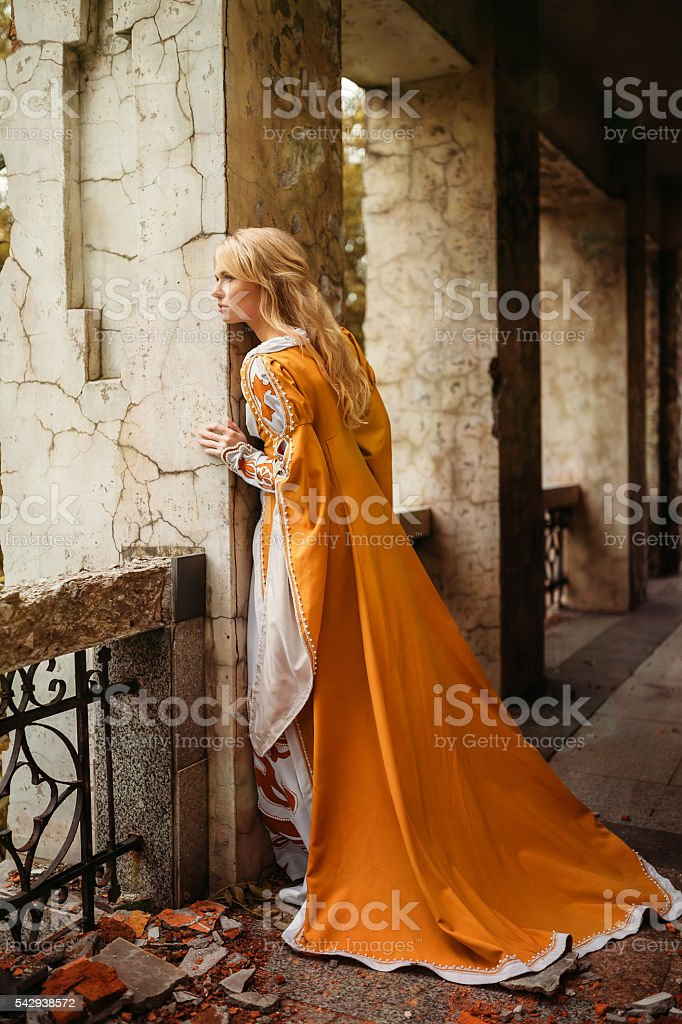 Woman in medieval dress stock photo