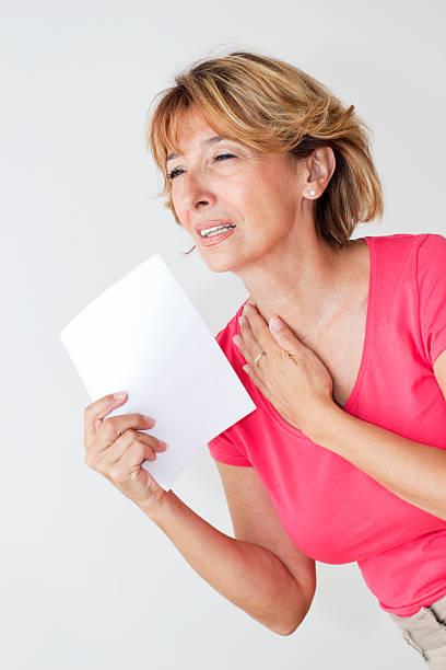 woman in menopause - mature woman fever on white bildbanksfoton och bilder