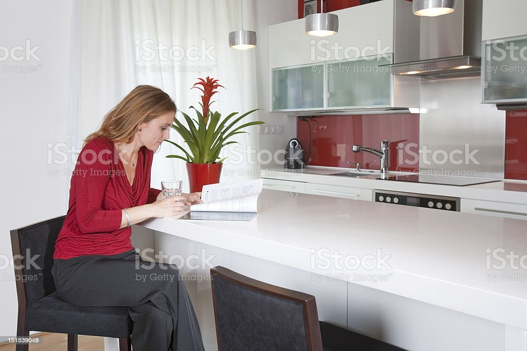 woman in modern kitchen royalty-free stock photo