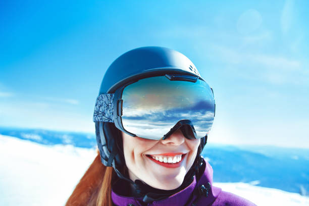 woman in mountain goggles Portrait of a Woman in the Alps in Glasses ski goggles stock pictures, royalty-free photos & images