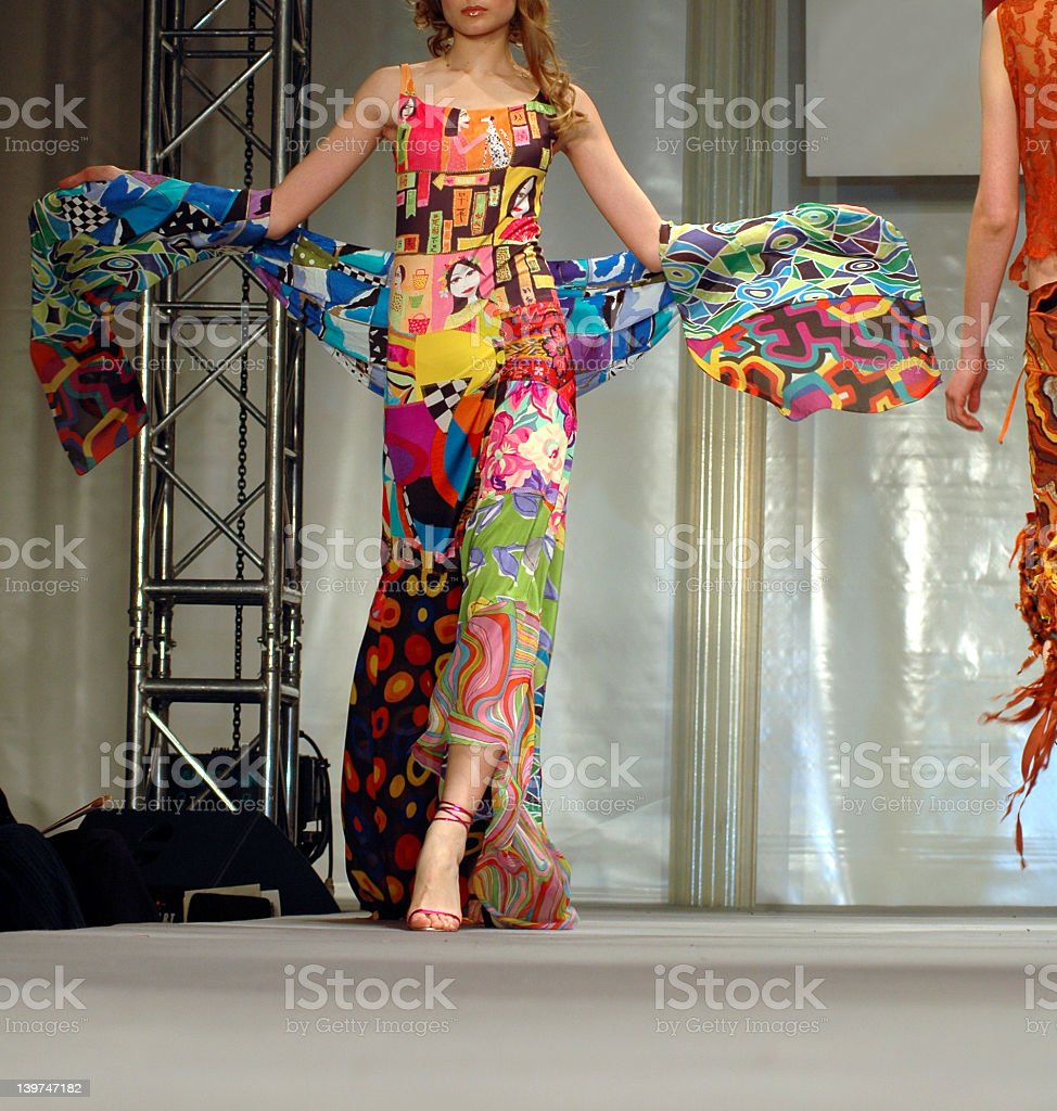 Woman in multicolored dress at a fashion show stock photo