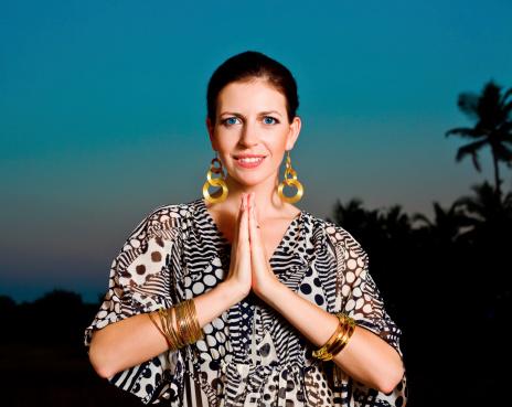 Woman In Namaste Pose Stock Photo - Download Image Now