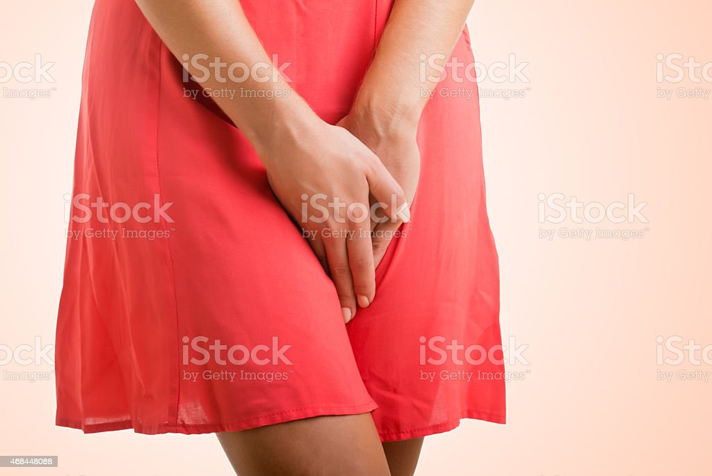 Woman in Need to Urinate stock photo