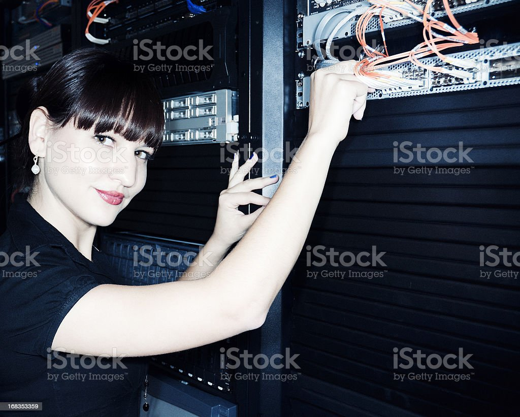 Woman in Network Server Room, IT Professional stock photo
