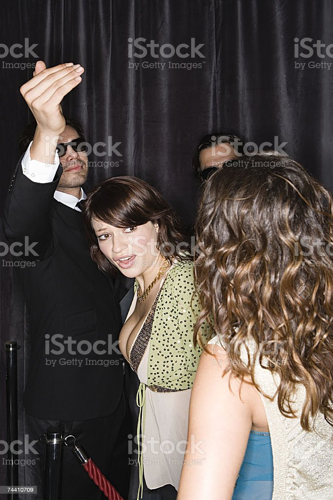 Woman in nightclub queue stock photo