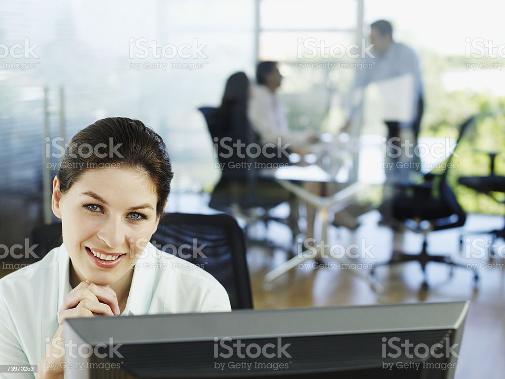 Woman in office working on her personal computer royalty-free stock photo