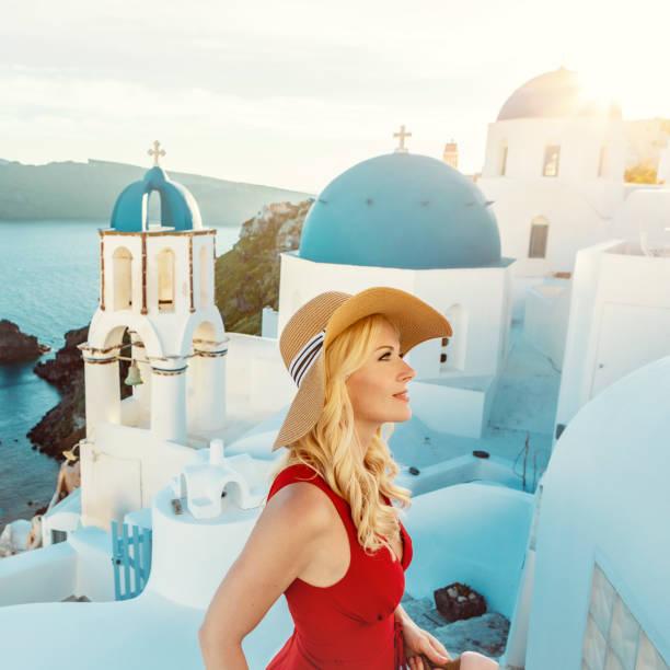 woman in Oia on Santorini stock photo