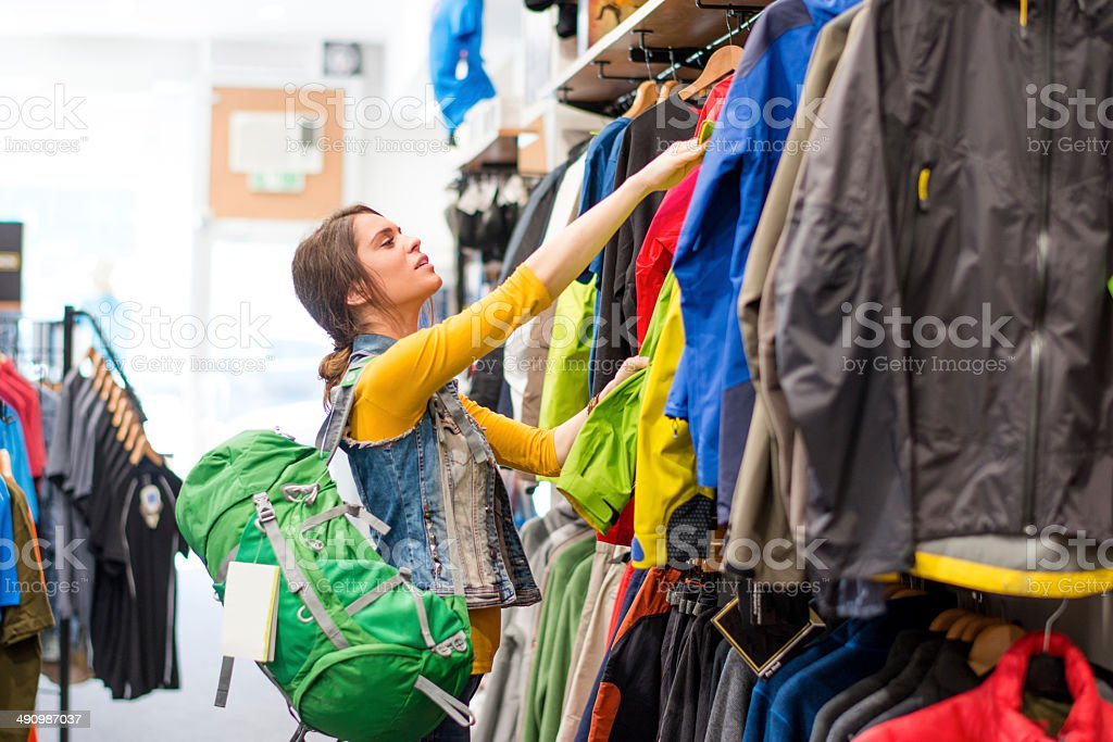 Woman in outdoor shop stock photo