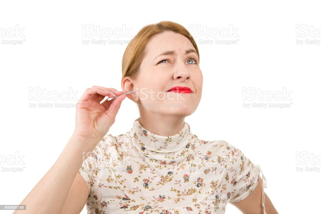 Woman In Pain From Cleaning Ear stock photo
