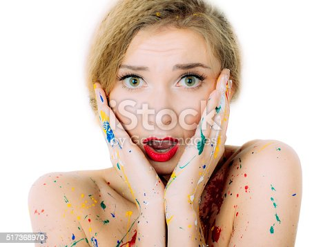 860245894istockphoto Woman in paint portrait  with red lips and surprising face 517368970