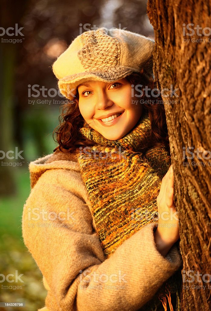 Woman in park on autumn day. stock photo