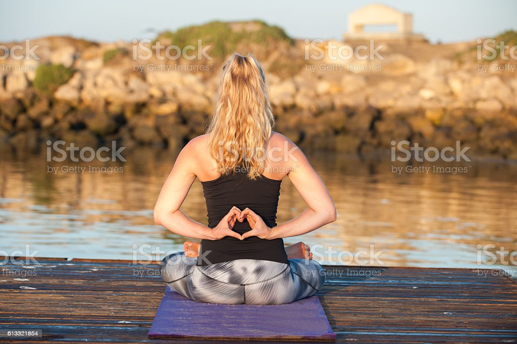 Woman in pattern tights in serene place for gratitude. stock photo