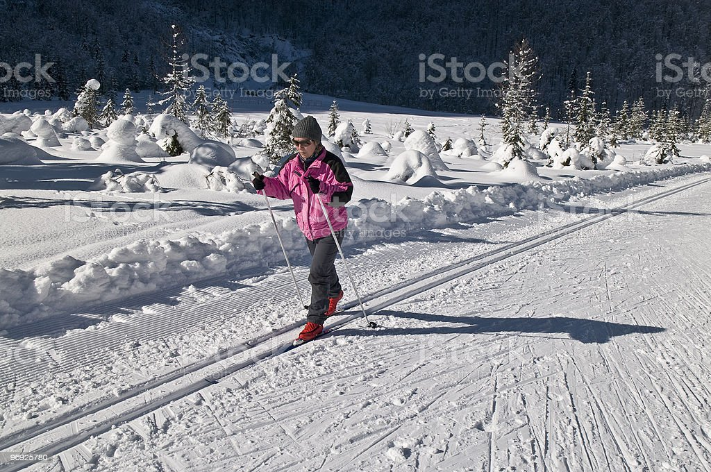 Woman in Pink Cross  Country Skiing royalty-free stock photo