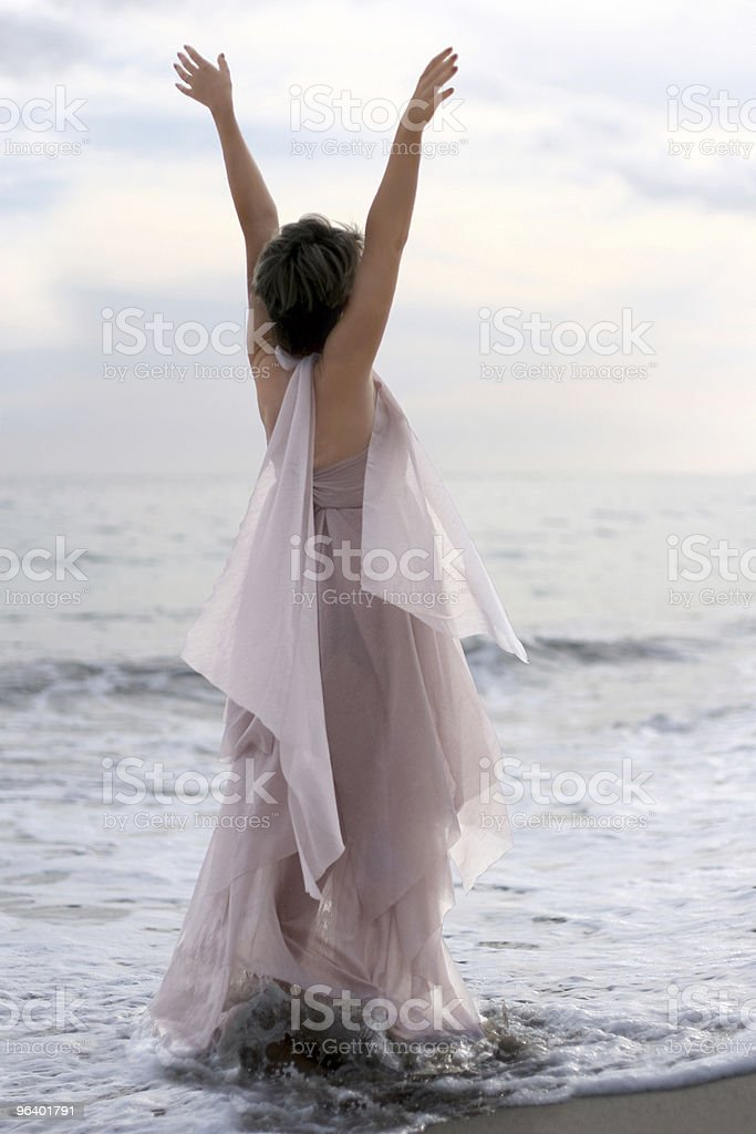 Woman in pink dress on the beach royalty-free stock photo