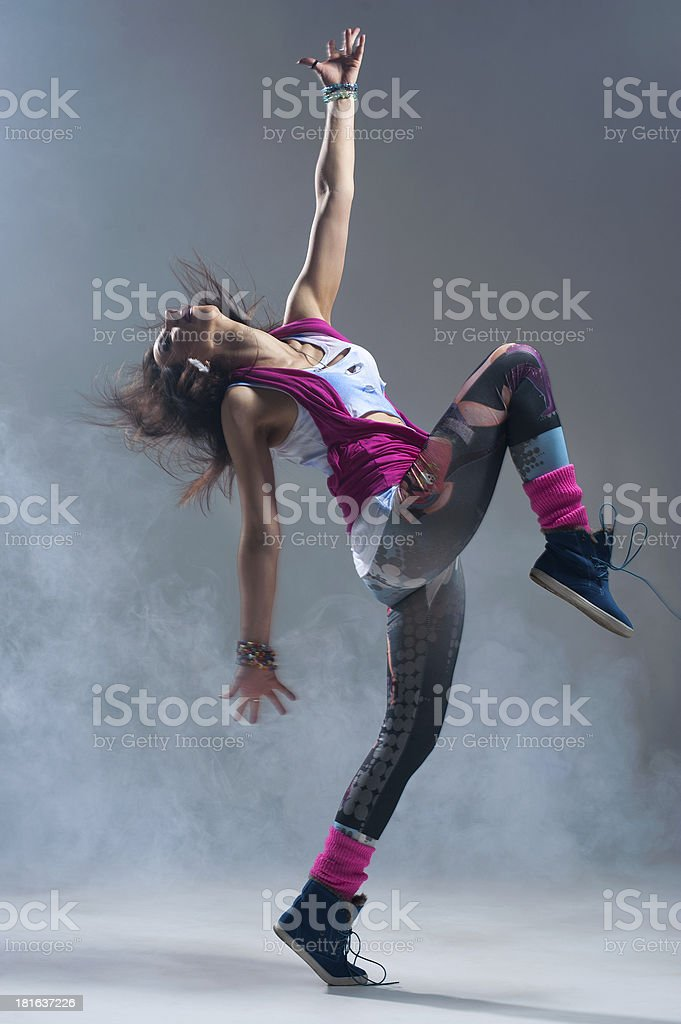 Woman in pink grunge clothes dancing at studio. royalty-free stock photo