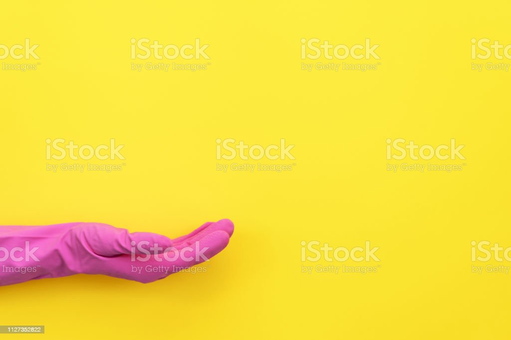 Woman In Pink Rubber Gloves Holding Hand Palm Up Showing