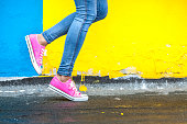 istock Woman in pink sneakers 831382888
