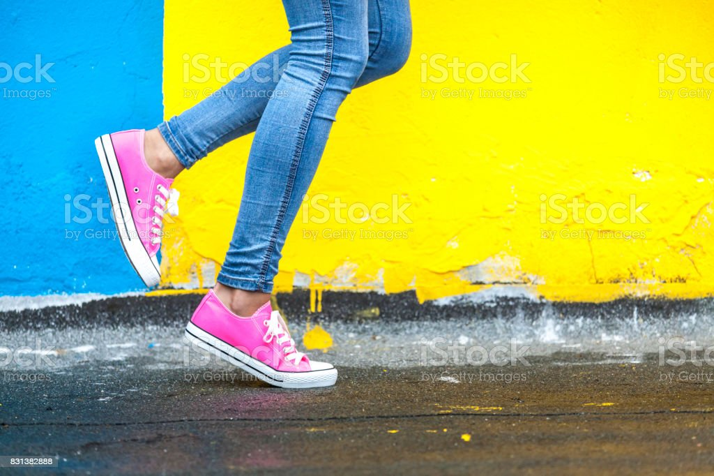 Woman in pink sneakers stock photo