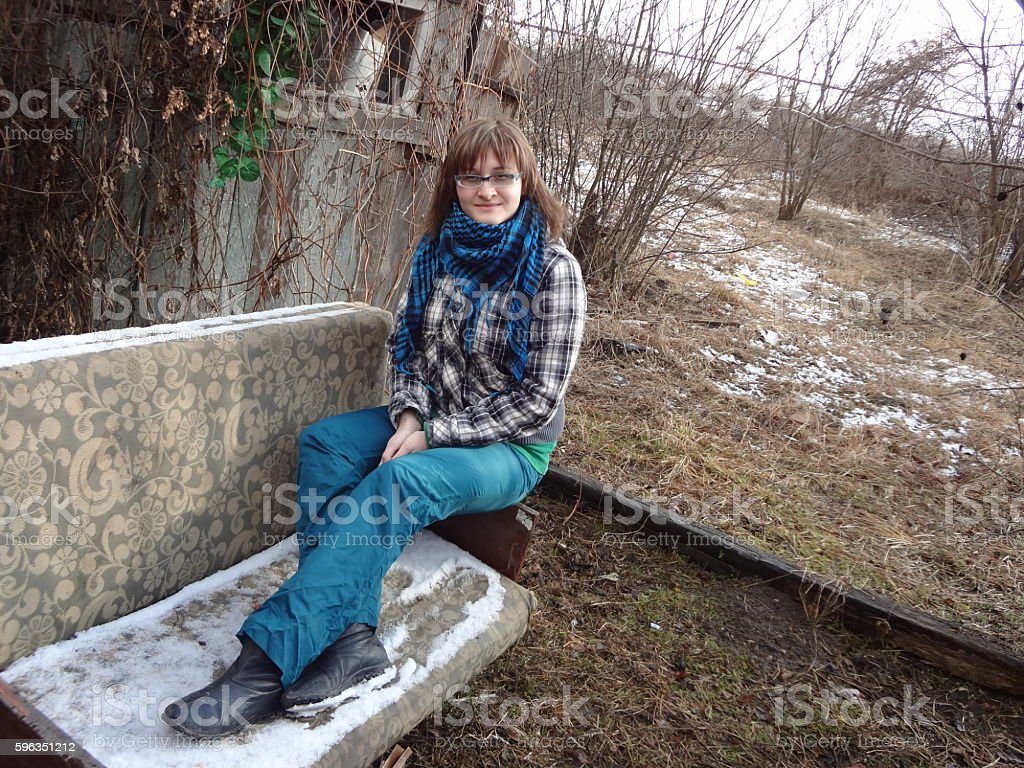 Woman in plaid jacket and cross scarf royalty-free stock photo