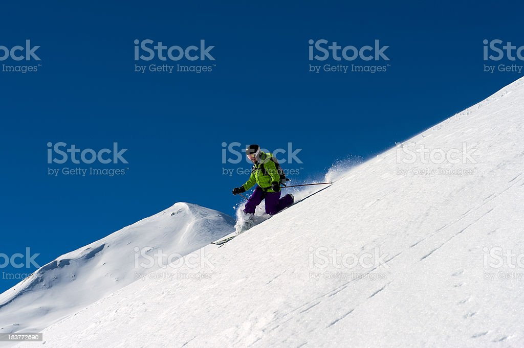 Woman in powder snow stock photo