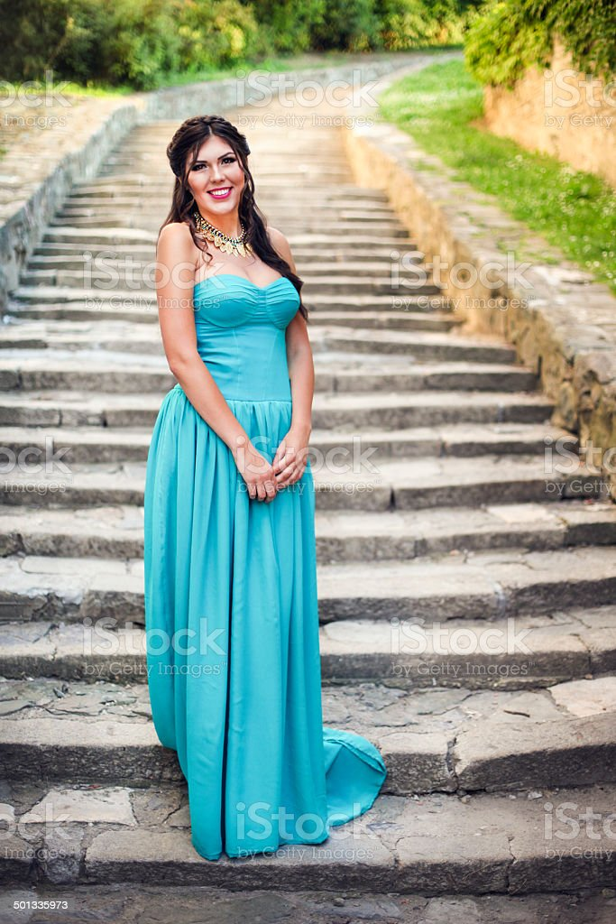 Woman in prom dress stock photo