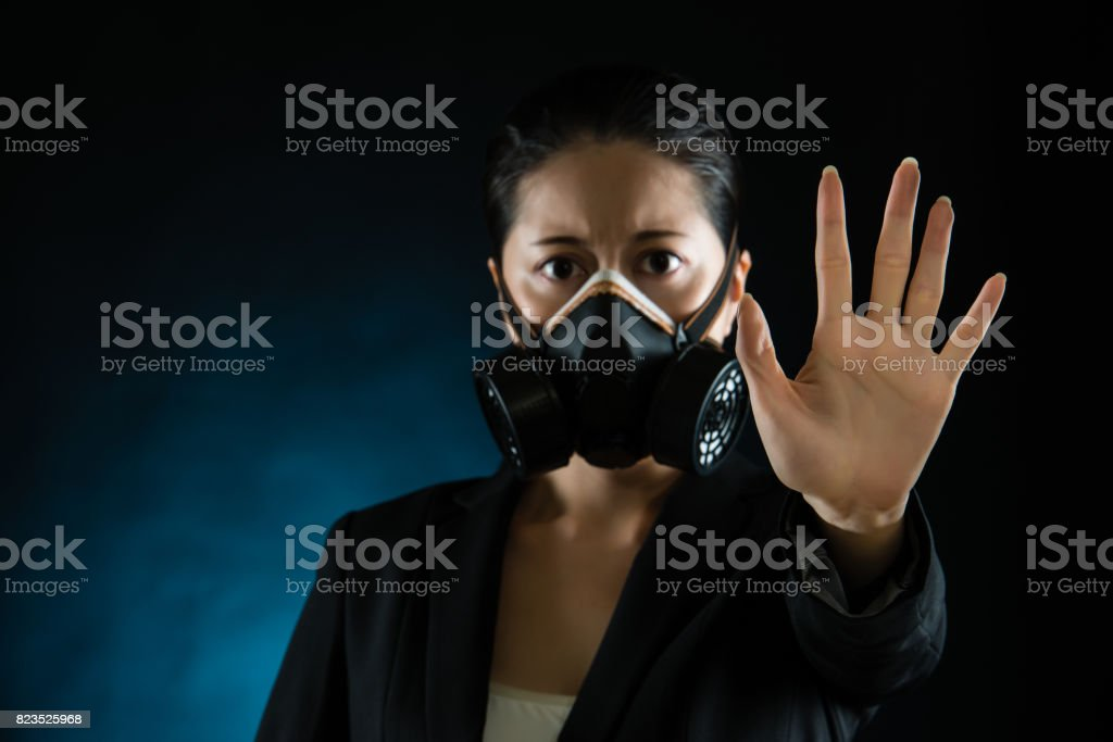 woman in protective mask with reject gesture hand stock photo