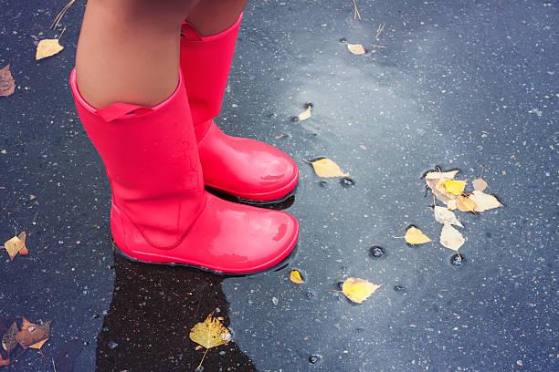 Woman in rain boots stock photo