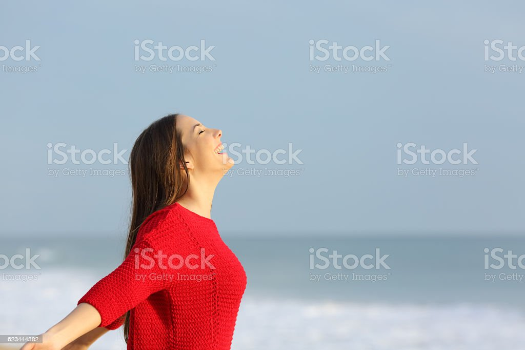 Woman in red breathing fresh air stock photo
