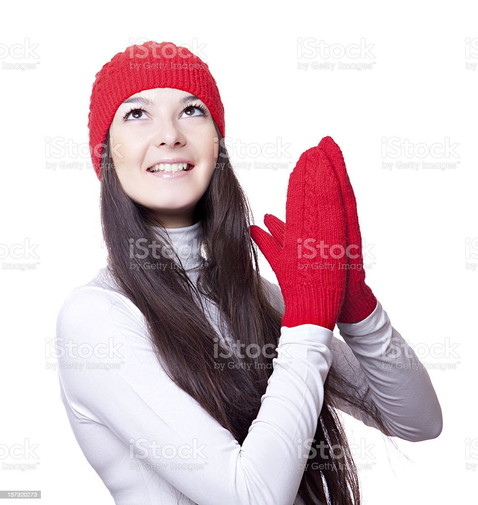 woman in  red cap and mittens rejoices royalty-free stock photo