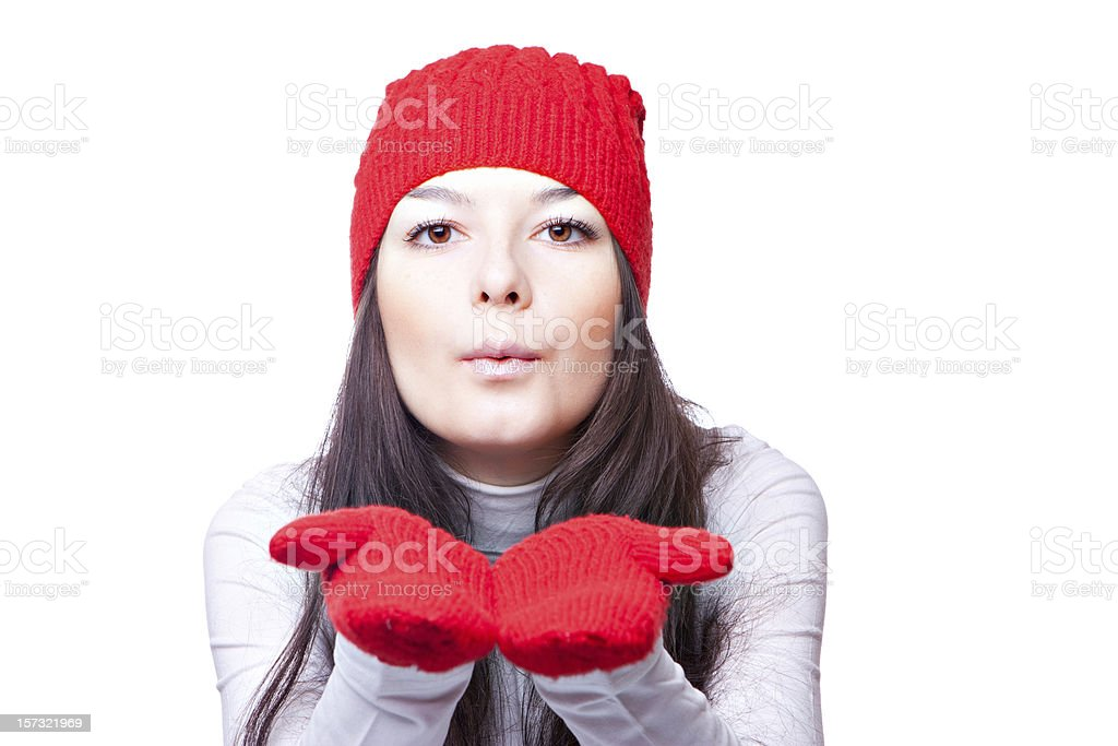 woman in red cap blows royalty-free stock photo