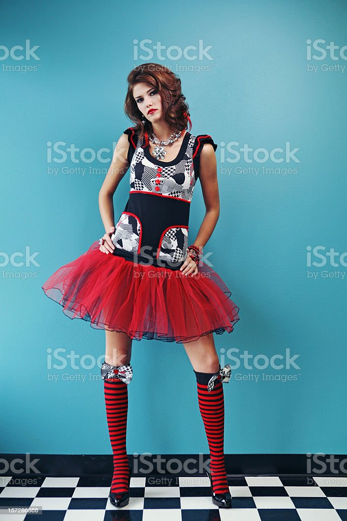 Woman in Red Dress and Stockings on Blue Wall royalty-free stock photo