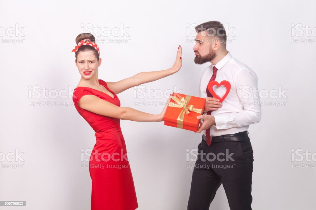 Woman in red dress, don't need present and love stock photo
