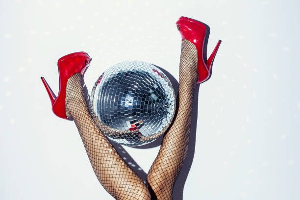 woman in red heels and disco ball - disco dancing stock photos and pictures