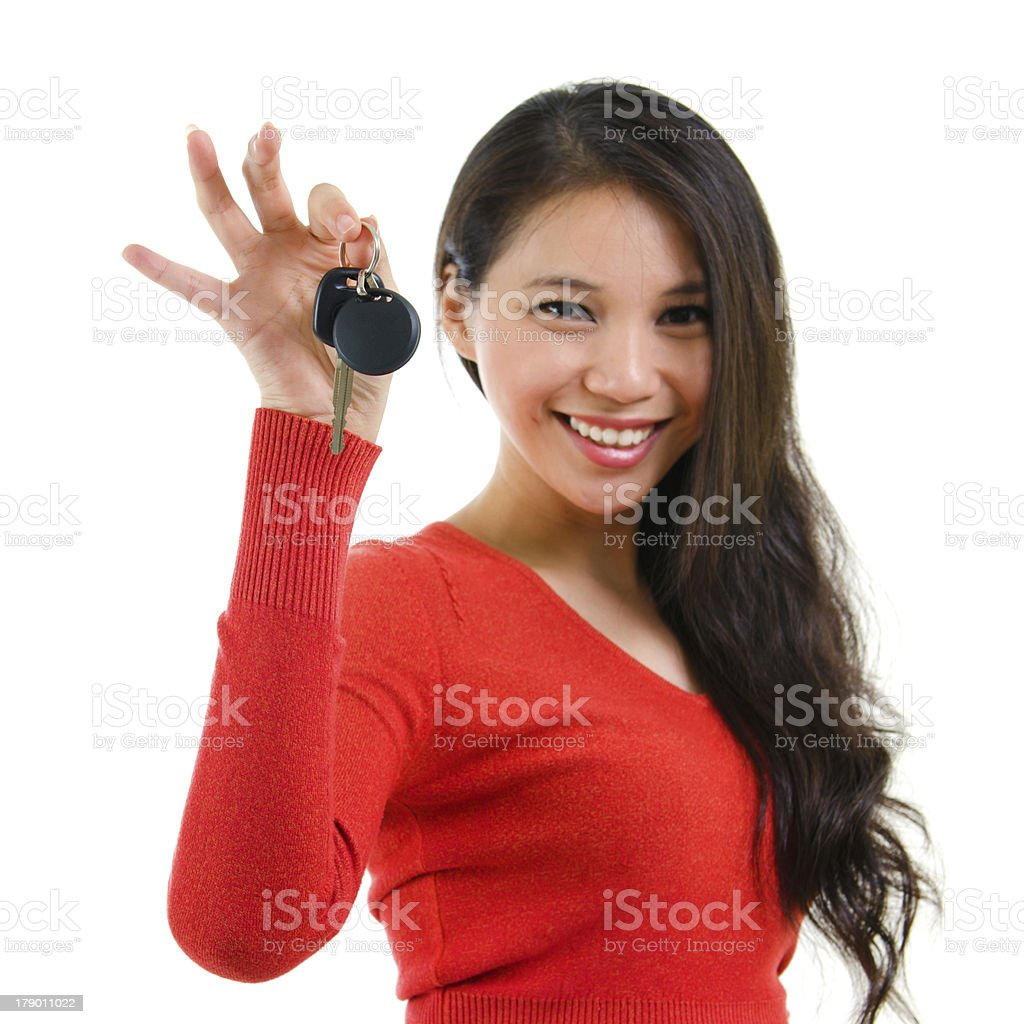 Woman in red holding a car key stock photo