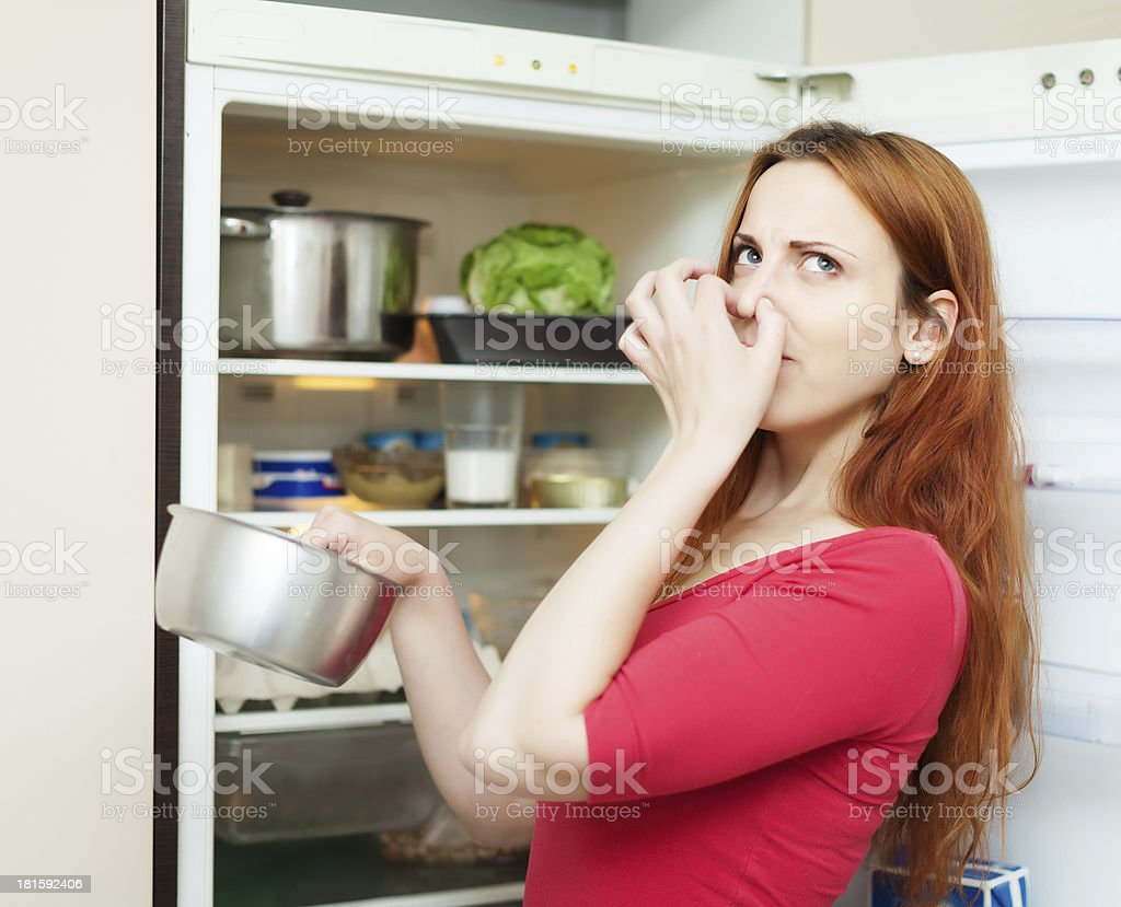 woman in red holding foul food stock photo
