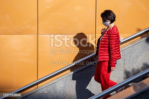 Woman going down the stairs to a local metropolitan station in Sofia, Bulgaria, in a time of pandemic