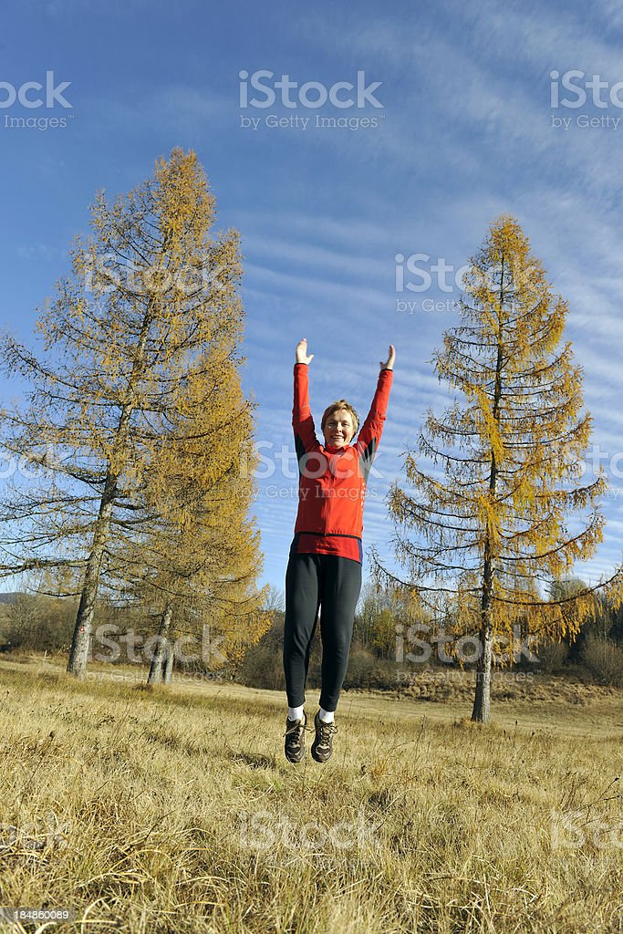 Woman in Red Jumping Autumn royalty-free stock photo