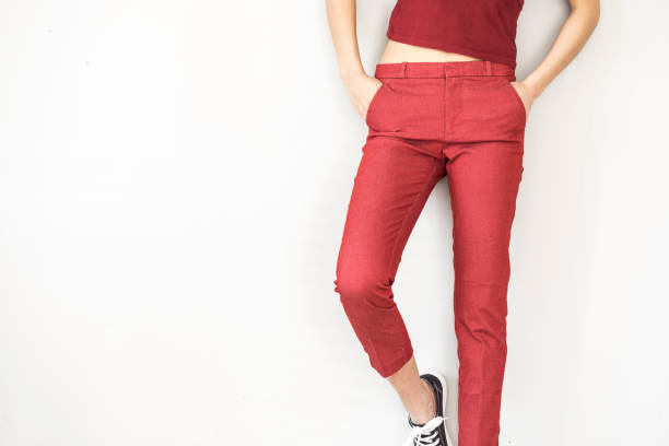 Woman in red pants and shirt stock photo
