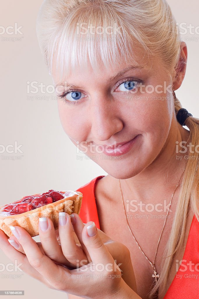 Woman in red posing with cake royalty-free stock photo