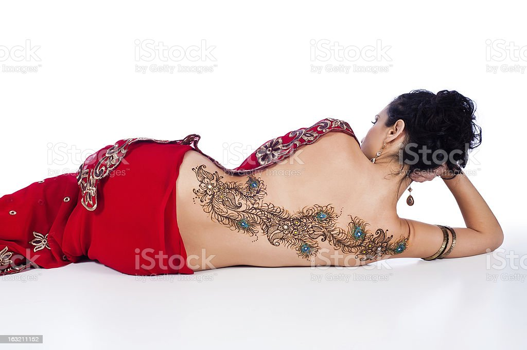 Woman in Red Sari with Henna Design on her Back stock photo